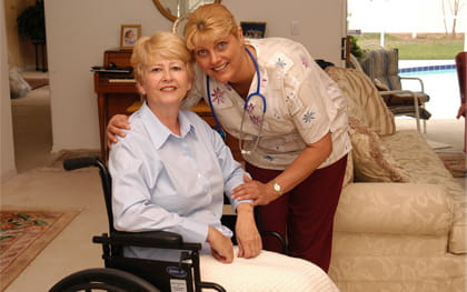 Recovery Patient in wheelchair with caregiver